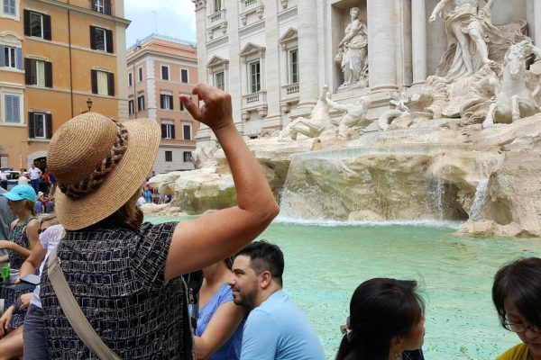 Tossing a coin into the Trevi fountain